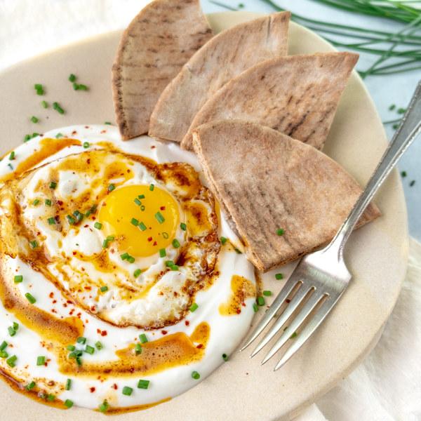 Turkish Eggs with Garlicky Yogurt, Chili Butter, Chives & Pita