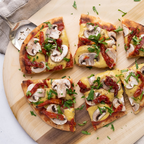 Cheesy Vegan Pizza with Mushrooms, Sun-dried Tomatoes & Basil