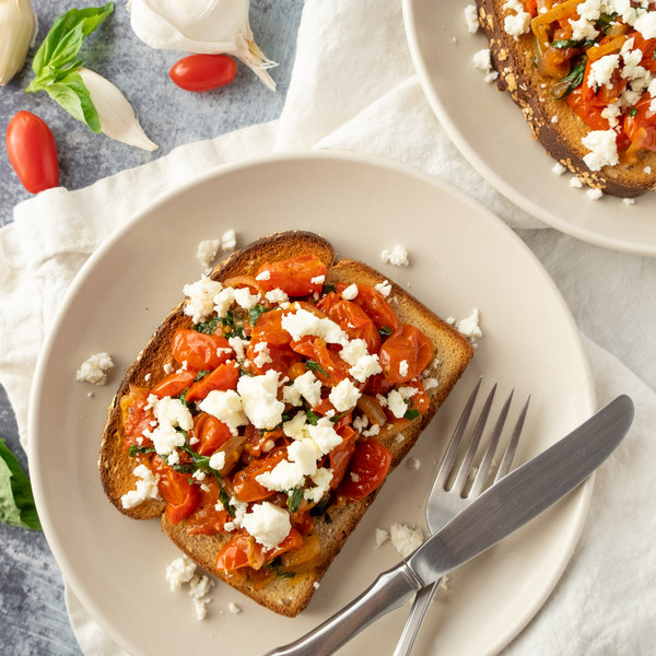 Pan-Fried Cherry Tomatoes with Basil & Feta over Toast