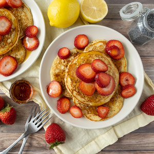 Lemon Poppy Seed Pancakes with Strawberries & Maple Syrup