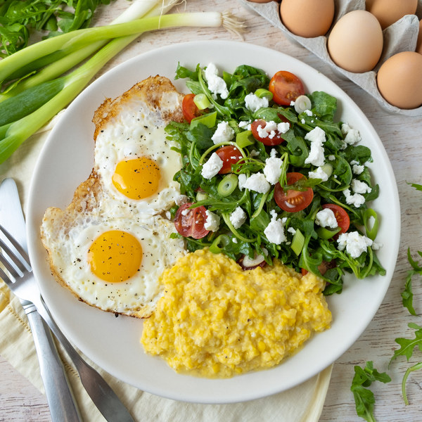 "Fresh Corn ""Polenta"" with Fried Eggs & Goat Cheese-Arugula Salad"