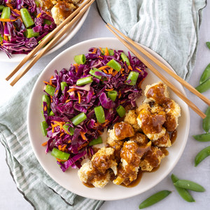 Sticky Asian Cauliflower Bites with Carrot & Snap Pea Slaw
