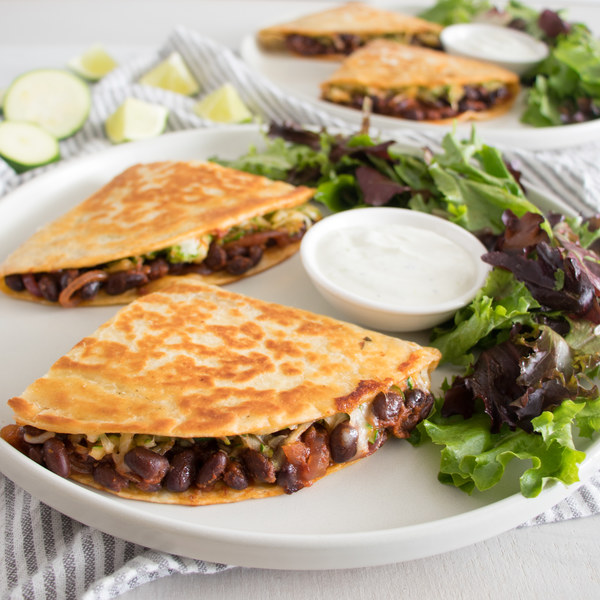 Black Bean-Zucchini Quesadilla with Zingy Greens & Lime Crema