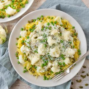"Cauliflower ""Alfredo"" over Spaghetti Squash with Peas & Pumpkin Seeds"