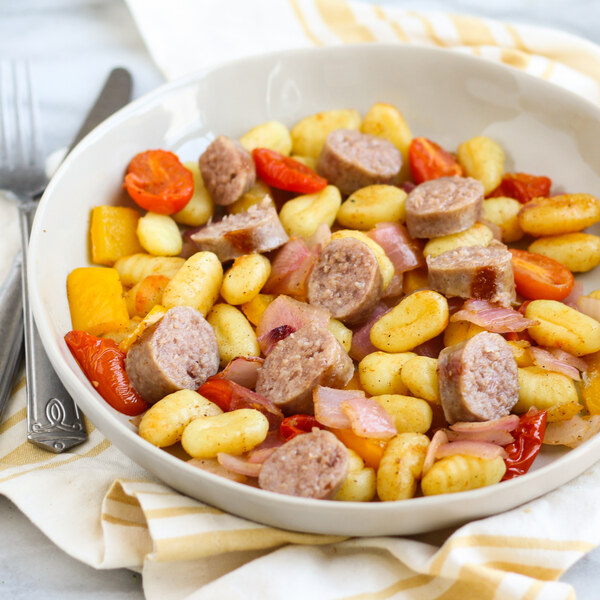Brown Sugar-Sage Gnocchi Bake with Sausage, Peppers, Tomatoes & Onion