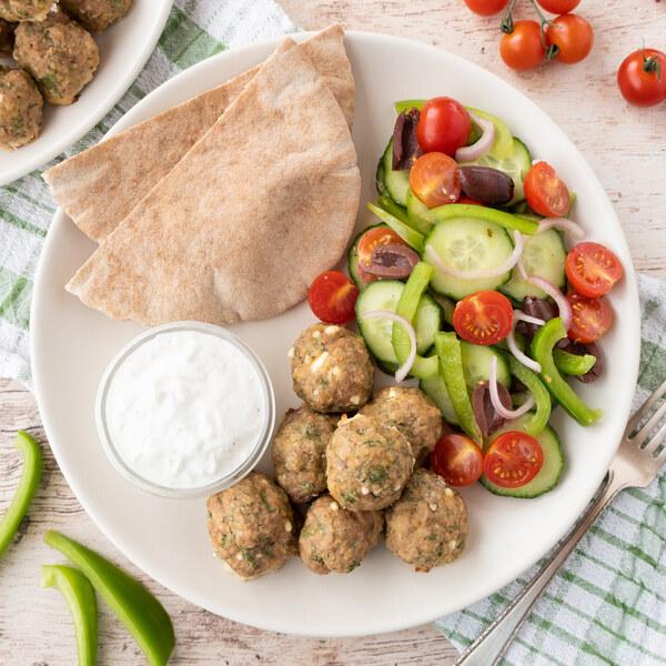 Greek Turkey Meatball Pita Wraps with Veggies, Olives & Feta Sauce
