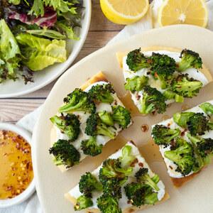 Charred Broccoli Flatbread with Lemony Ricotta, Chili Honey & Salad