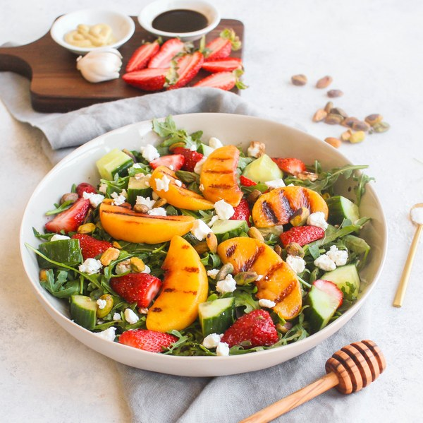 Grilled Peach, Strawberry & Arugula Salad with Pistachios & Goat Cheese