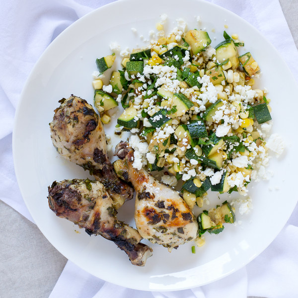 Lemon-Garlic Chicken Drumsticks with Zucchini, Corn & Feta Salad