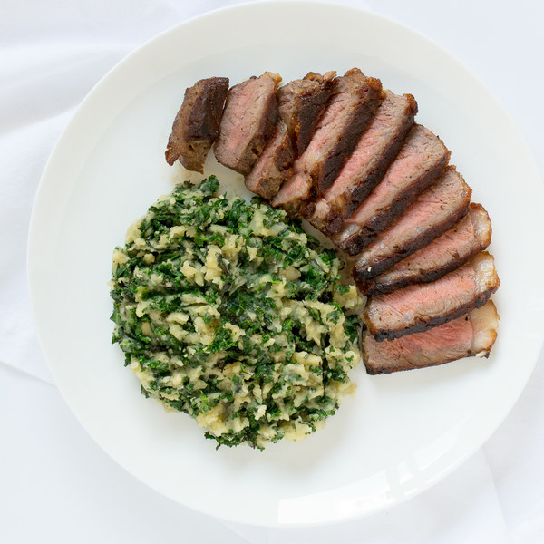 Pan-Seared Strip Steak with Kale Colcannon (Irish Mashed Potatoes)