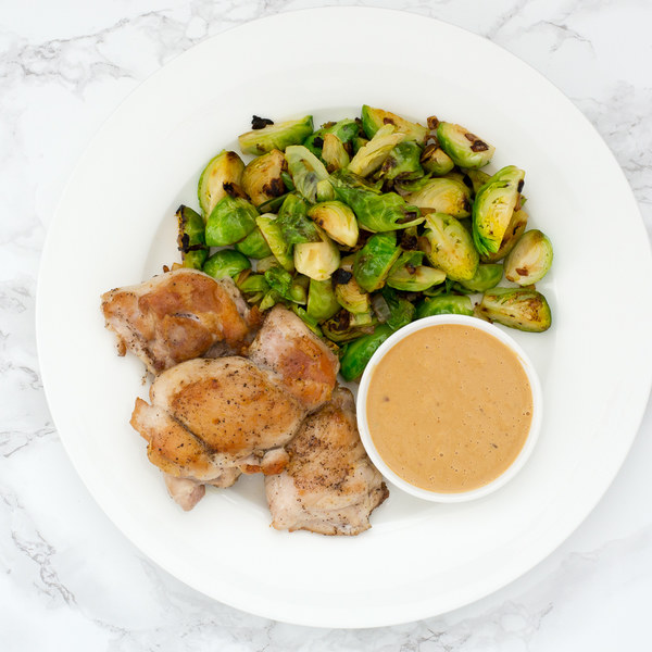 Sautéed Chicken Thighs with Brussels Sprouts & Peanut Sauce