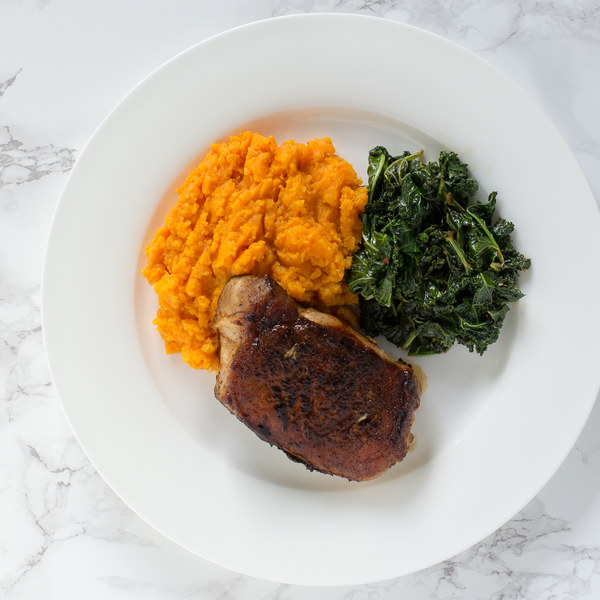 Pan-Fried Pork Chops with Sautéed Kale & Sweet Potato Mash