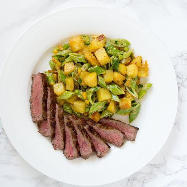 Striploin Steak with Warm Potato, Corn & Snap Pea Salad