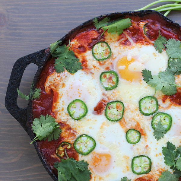 Eggs Baked in Tomatoes  with Cheese, Cilantro, and Jalapeno Pepper