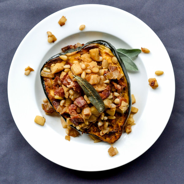 Stuffed Acorn Squash with Apple, Bacon & Pine Nuts