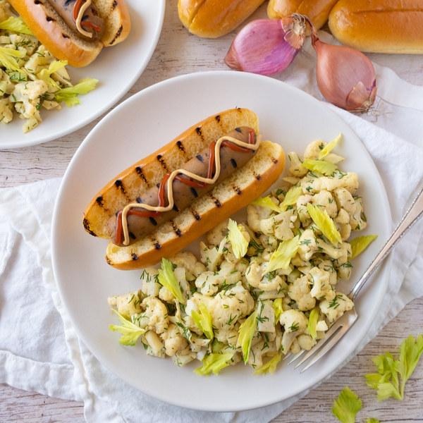 "Grilled Vegan Sausage Dogs with Cauliflower ""Potato"" Salad"