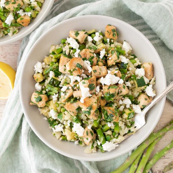 Lemon-Herb Chicken over Primavera Cauliflower Rice Salad with Feta