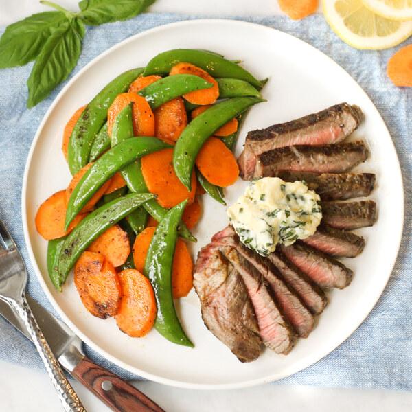 Sirloin Steak with Basil Compound Butter, Snap Peas & Carrots