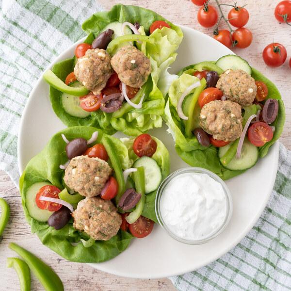 Greek Turkey Meatball Lettuce Wraps with Veggies, Olives & Feta Sauce