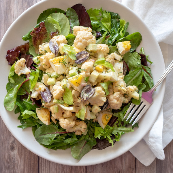 Deli Style Cauliflower, Olive & Egg Salad Over Mixed Greens
