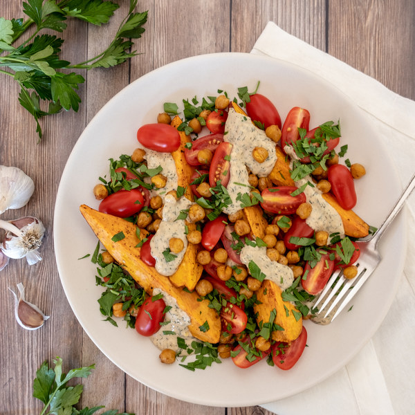 Mediterranean Sweet Potatoes with Chickpeas & Garlic-Tahini Sauce